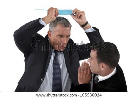 Angry boss hitting employee - stock photo