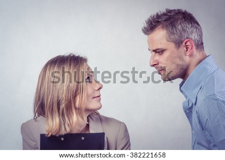 Angry boss scold and threaten his employer woman and she is surprised and shocked - stock photo
