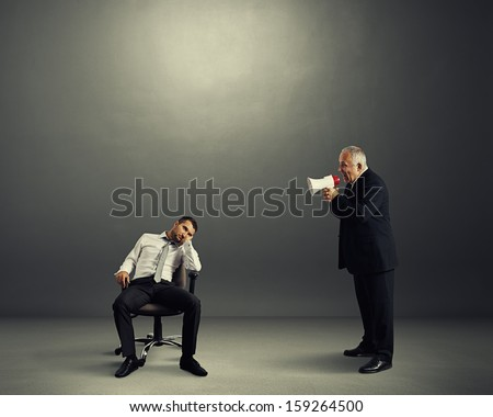 angry boss screaming at lazy worker - stock photo