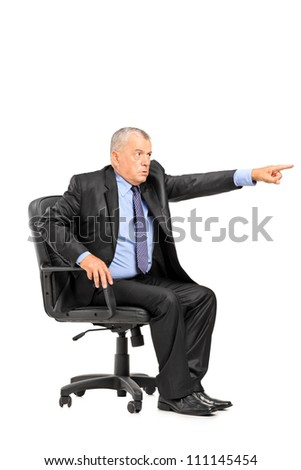 Angry boss sitting in armchair and pointing his finger isolated on white background - stock photo
