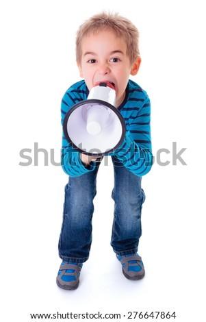 Angry boy shouting into big white megaphone - stock photo