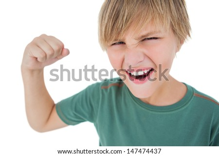 Angry boy tensing arm muscle on white background