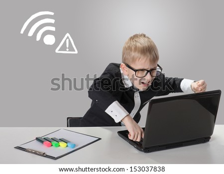 Angry boy with laptop. Connection closed. No wireless connection available.  - stock photo