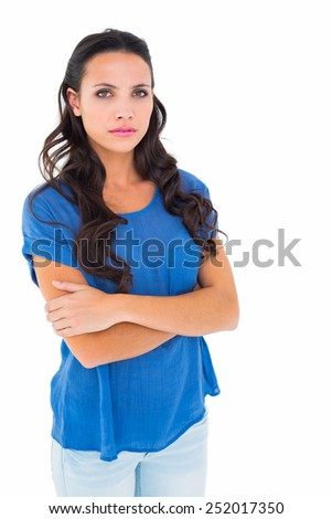 Angry brunette frowning at camera on white background - stock photo