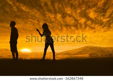 Angry brunette shouting at boyfriend against beautiful african scene - stock photo