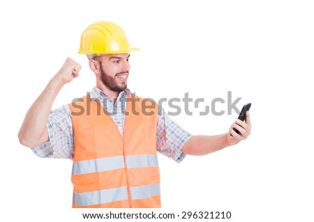 Angry builder, engineer or construction worker ready to hit the phone - stock photo
