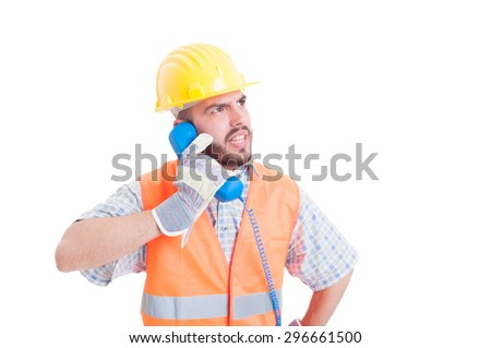 Angry builder having a conversation on the phone isolated on white background - stock photo
