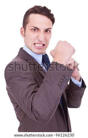 angry business man holding his fists into camera. Isolated on white background - stock photo