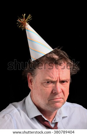Angry Business Man in a Party Hat - stock photo