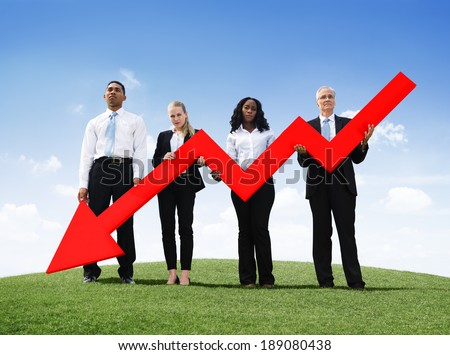 Angry Business Man Outdoors Holding Declining Line Graph - stock photo