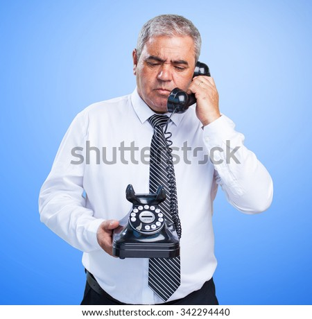 angry business man talking on telephone - stock photo