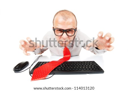 Angry business man with computer keyboard and mouse, isolated on white background - stock photo