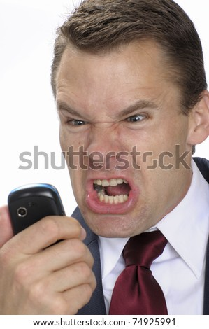 Angry business man yells into cell phone