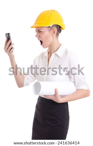angry business woman architect in yellow builder helmet shouting on phone isolated on white background
