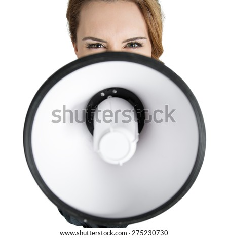 Angry  business woman shouting with a megaphone over white background. Focus on eyes