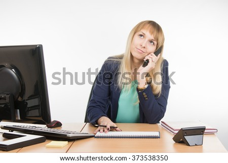 Angry business woman talking on the phone and looking up - stock photo