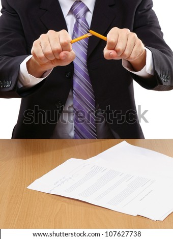 Angry businessman breaking pencil isolated - stock photo