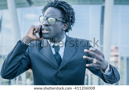 Angry businessman during a call on the phone - black people - concept about people, lifestyle, business and technology - stock photo