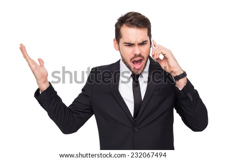 Angry businessman gesturing on the phone on white background - stock photo