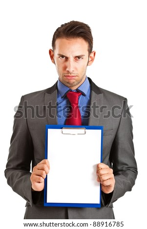 Angry businessman holding a blank card in which to put your text - stock photo
