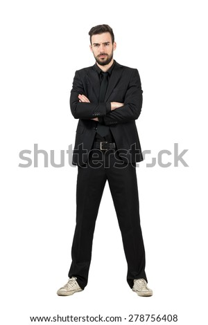 Angry businessman in suit and sneakers with crossed arms looking at camera. Full body length portrait isolated over white studio background.  - stock photo