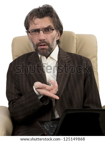 angry businessman in suit sitting in chair with notebook isolated white - stock photo