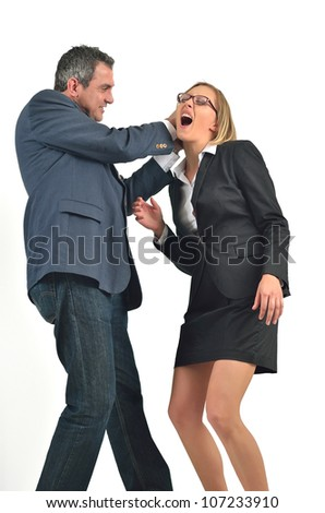 Angry businessman is hitting the businesswoman - stock photo