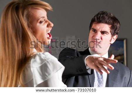 angry businessman is slapping across the businesswoman's face