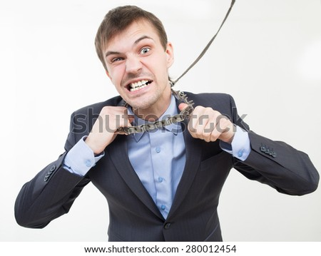 Angry businessman on the chain with a collar.  - stock photo