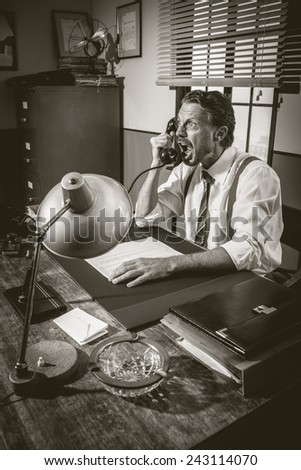 Angry businessman on the phone shouting out loud, 1950s vintage office.