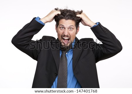 Angry businessman pulling his hair  - stock photo