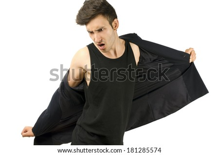 Angry businessman ripping his clothes ready to go in vacation after a stressful day at the office