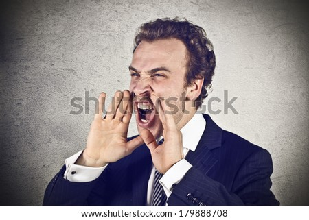 Angry businessman scream