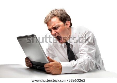 Angry businessman screaming against a laptop