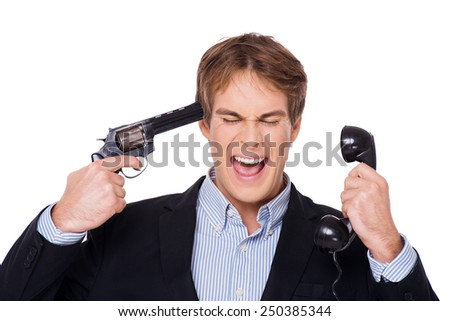 Angry businessman screaming, holding telephone and gun at temple. Concept for hard work and office problems