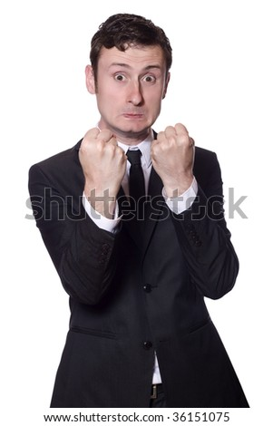 angry businessman showing boxing gesture on an isolated white background