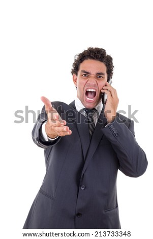 angry businessman while he talking on mobile - stock photo