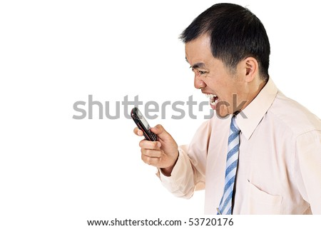 Angry businessman with cellphone on white background. - stock photo