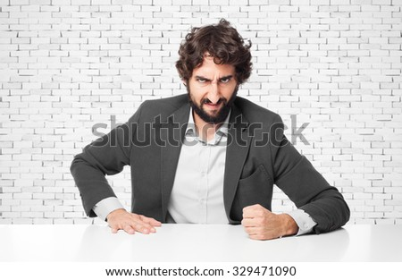 angry businessman with sit table