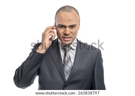 Angry businessman with telephone