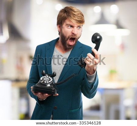 angry businessman with telephone - stock photo