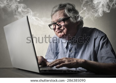 Angry businessman working at pc - stock photo