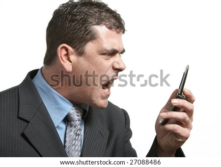 Angry businessman yelling on his cell phone - stock photo