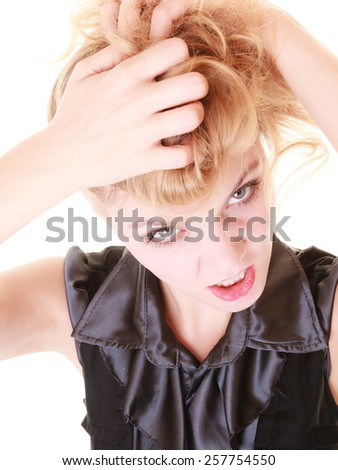 Angry businesswoman crazy boss furious woman pulling her messy hair isolated on white. Stress and negative emotions. - stock photo