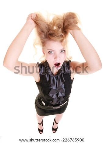 Angry businesswoman crazy boss furious woman screaming and pulling messy hair isolated on white. Stress and negative emotions. - stock photo