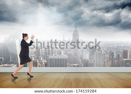 Angry businesswoman gesturing against cityscape on a wall