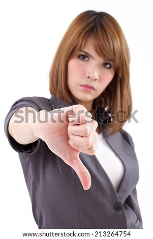 angry businesswoman giving, showing thumb down hand gesture on white isolated background, concept of not ok, rejection, nonacceptance, failure, negative result - stock photo