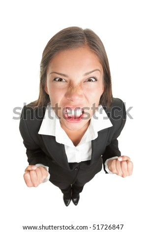Angry businesswoman isolated. Funny image of young asian business woman upset looking at the camera. Isolated on white background. - stock photo