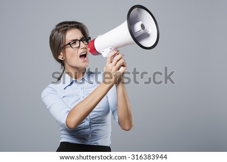 Angry businesswoman screaming very loud - stock photo