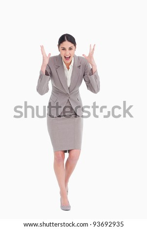 Angry businesswoman shouting against a white background - stock photo